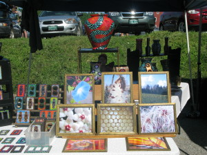 Vendors of arts and crafts are part of the diverse mix at the Saturday market