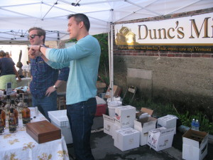 Dunc's Mill artisanal liquors are popular among visitors to the Saturday market